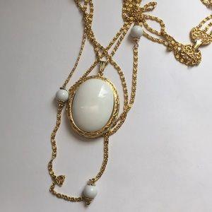 Multi strand graduated goldette locket necklace